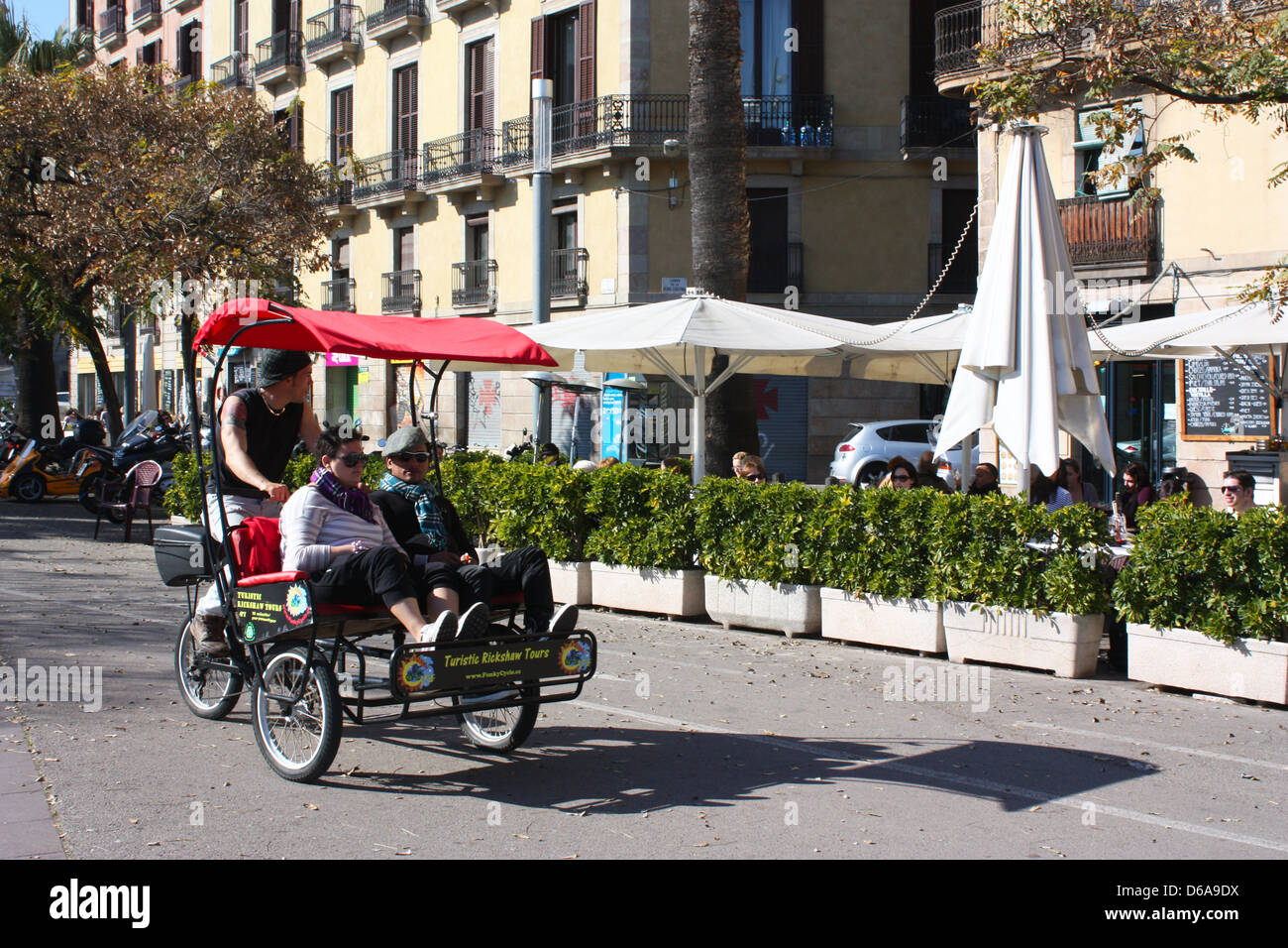 Tourists on tricycle in Barcelona, Spain Stock Photo