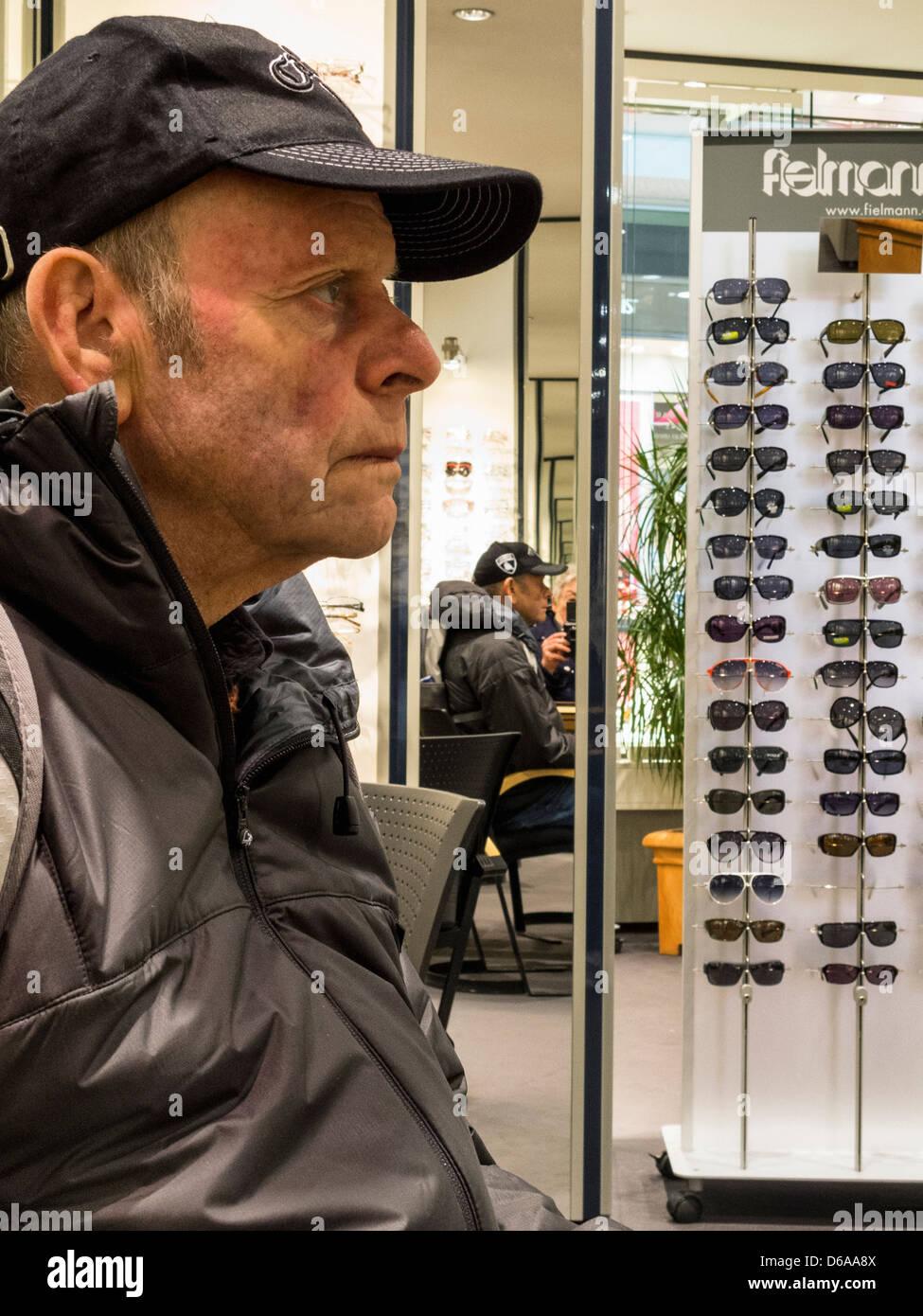Senior man waiting for an optician - Stock Image