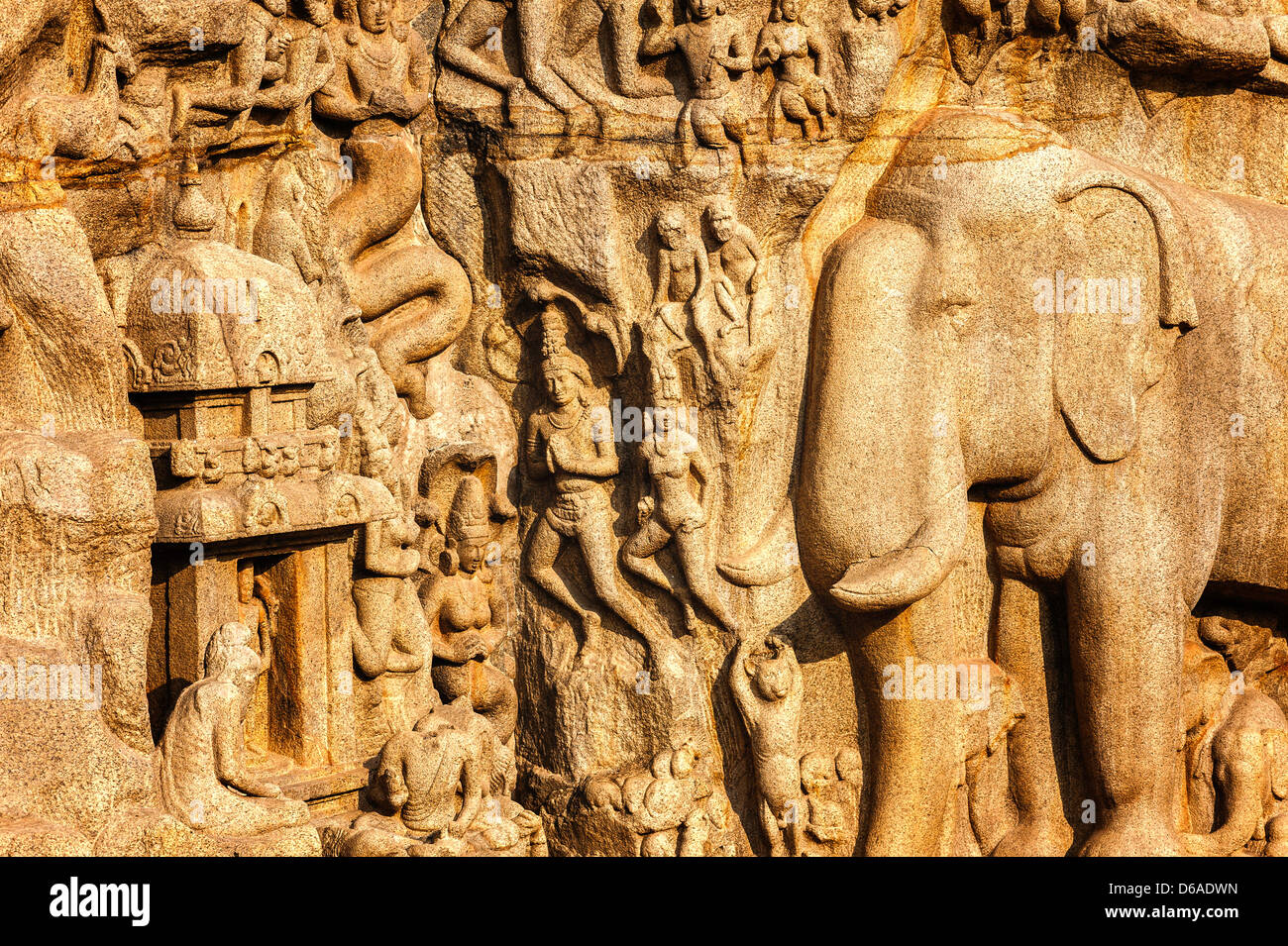 Mythological Hindu figures, animals, and other religious monolithic carvings dating back to 7th century at Mamallapuram, - Stock Image