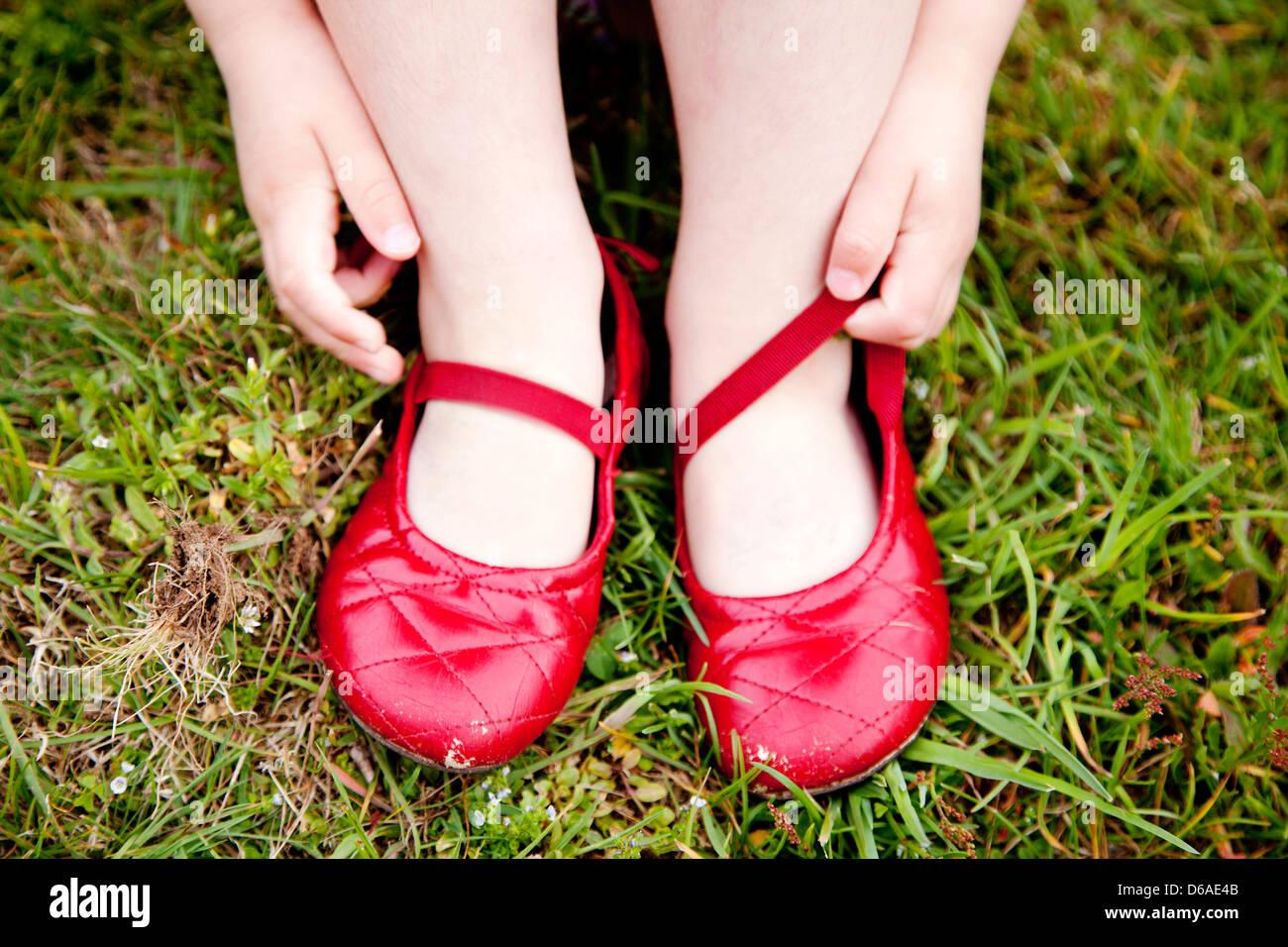 de76423bed0 Girl s Red Ballet Slippers Stock Photo  55549659 - Alamy