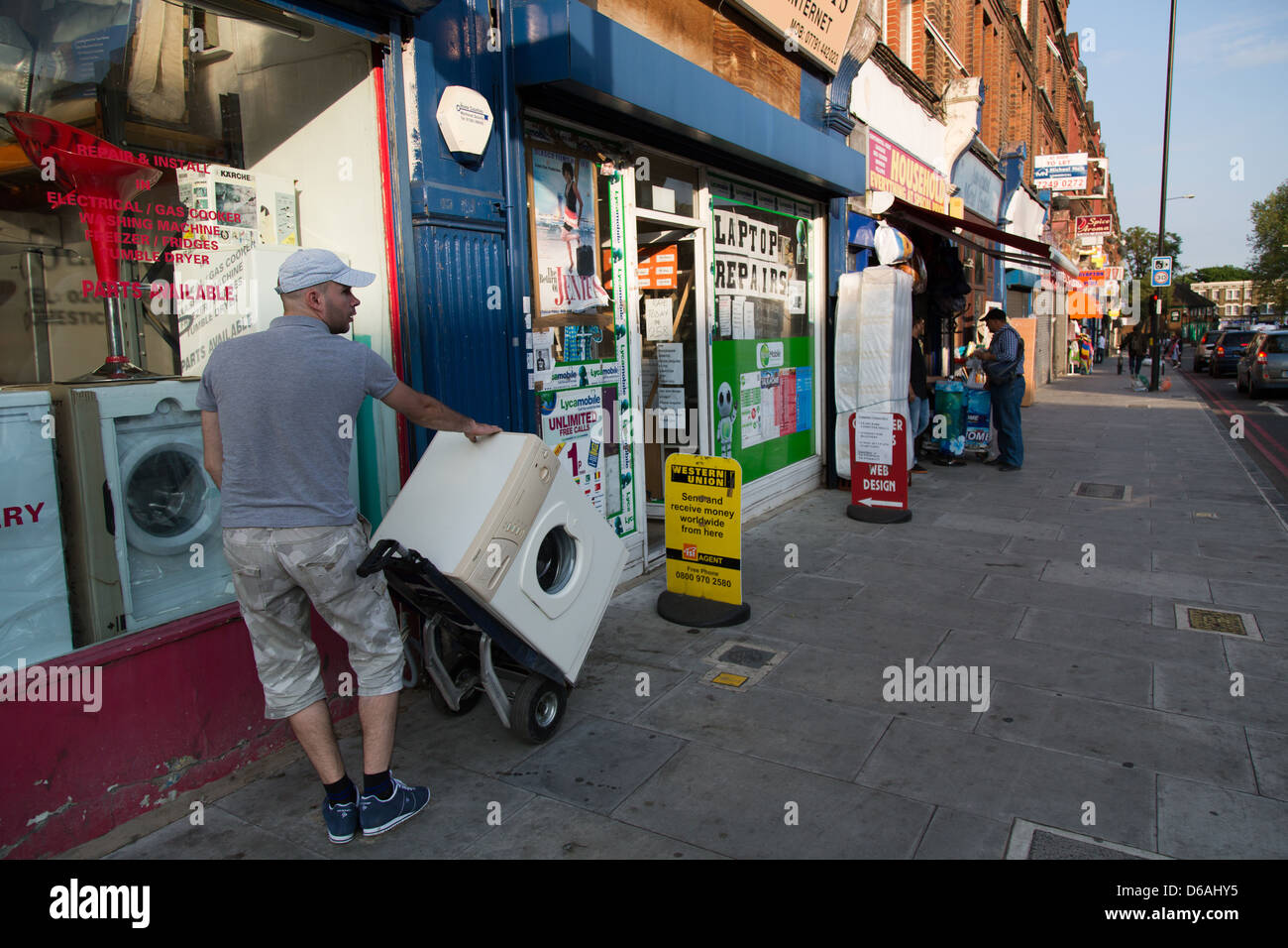 London, United Kingdom, an employee of one on business for washing machines - Stock Image