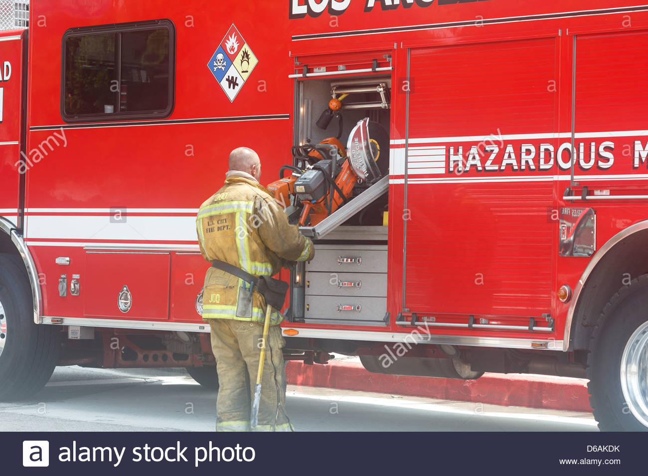 a los angeles firefighter removes a k 12 saw from the urban search