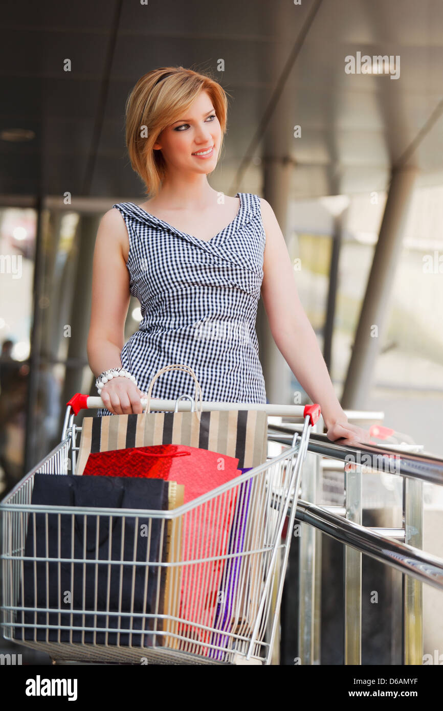 Young woman with shopping cart Stock Photo