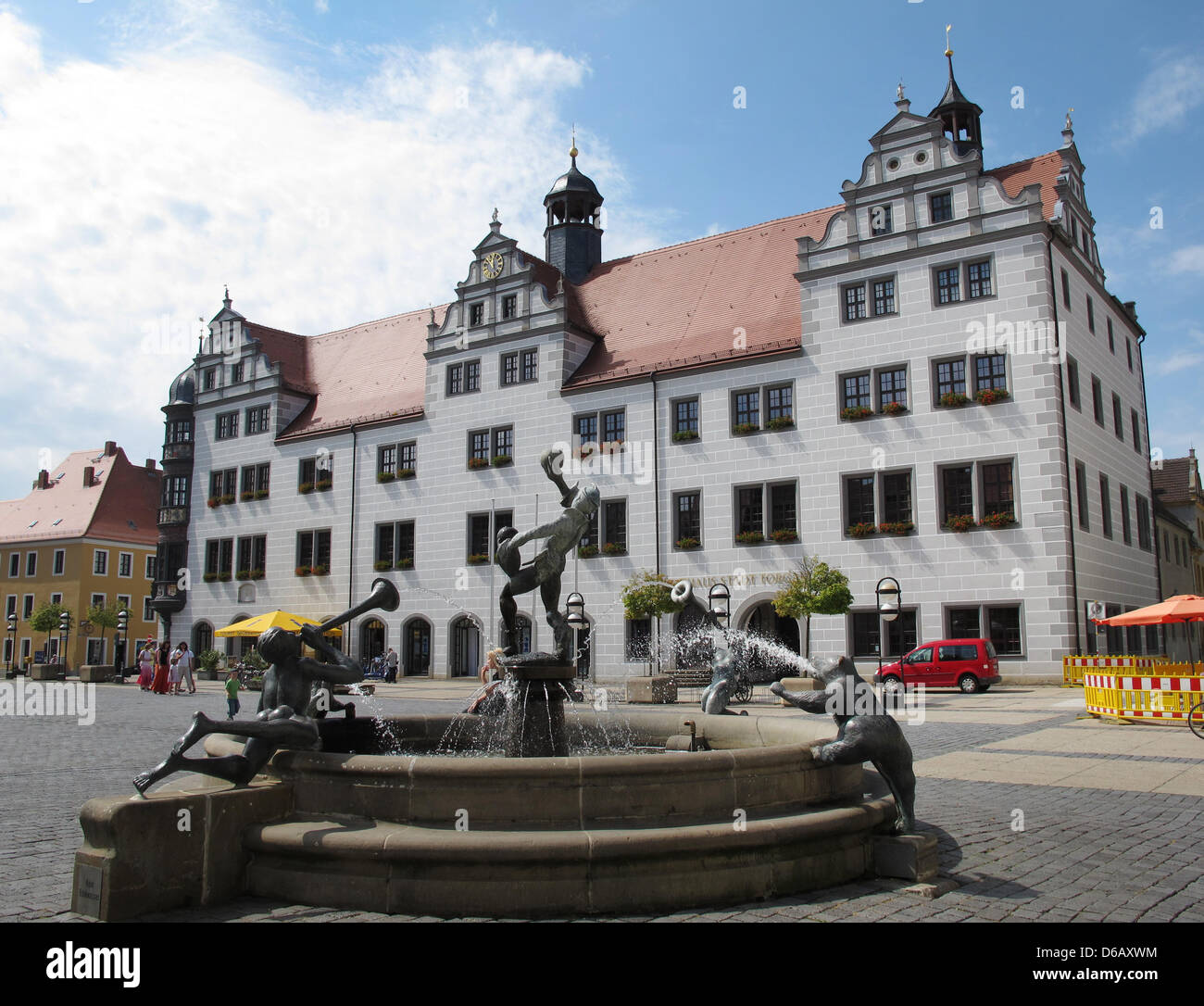 The town hall and fountain situated at the market place of the city Torgau are pictured on 04 August 2012, Germany. Stock Photo