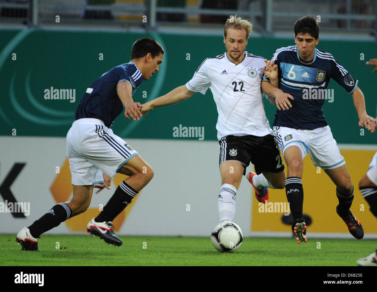 Germany's Maximilian Beister (C) vies for the ball with Argentina's Lisandro Magallan (L) and Lautaro Gianetti - Stock Image