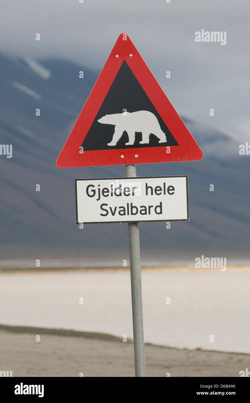Norway, Svalbard Archipelago, Spitsbergen, Longyearbyen. Caution sign about the danger of polar bears in the area. - Stock Image