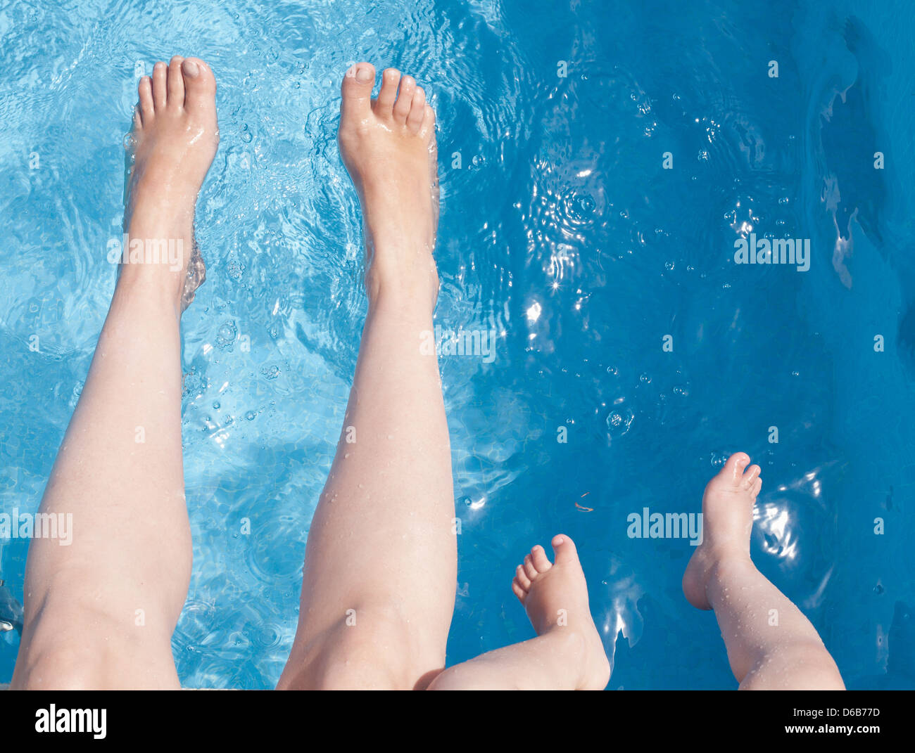 Mother and son playing in swimming pool - Stock Image