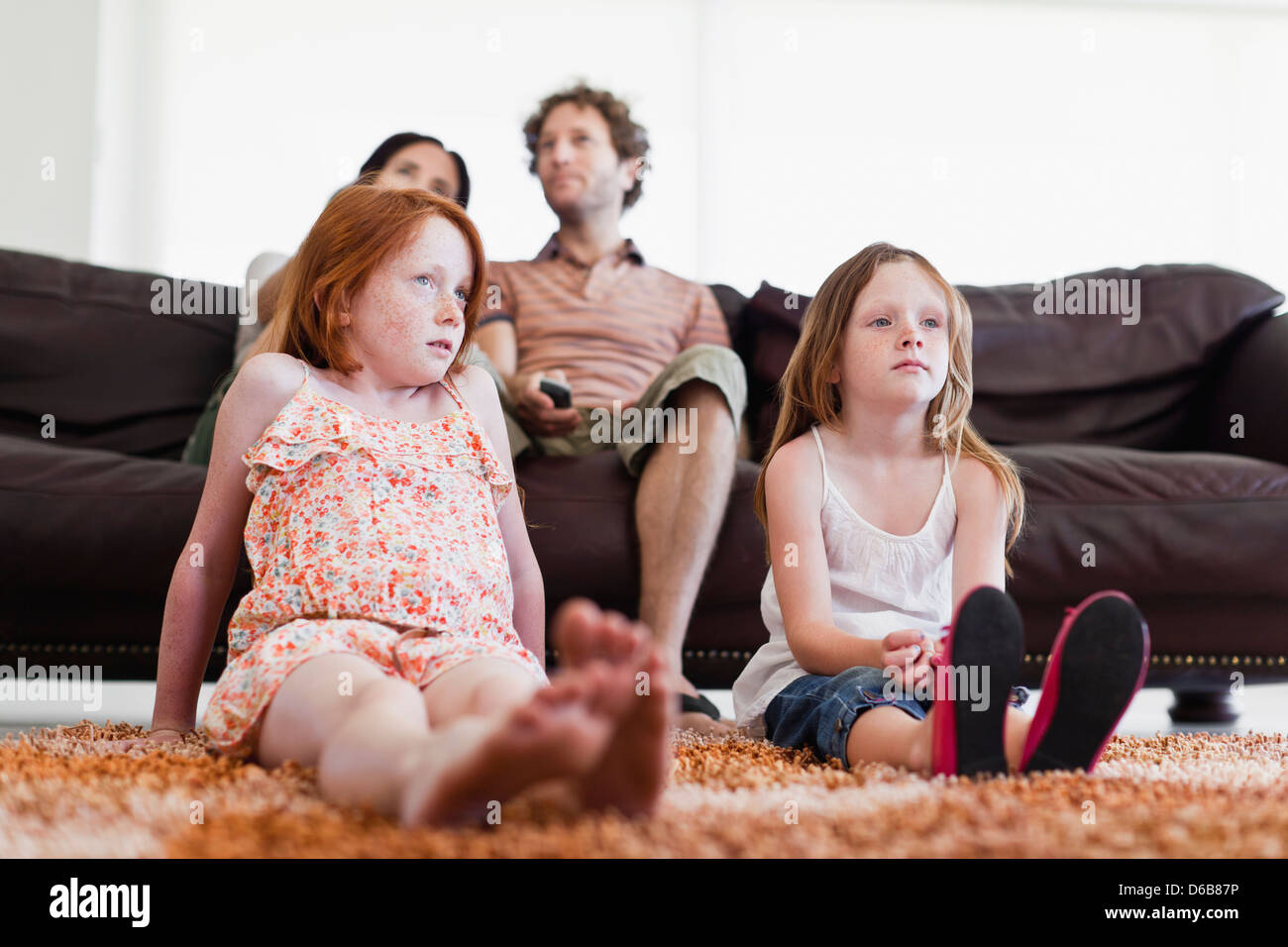 Family watching television together - Stock Image