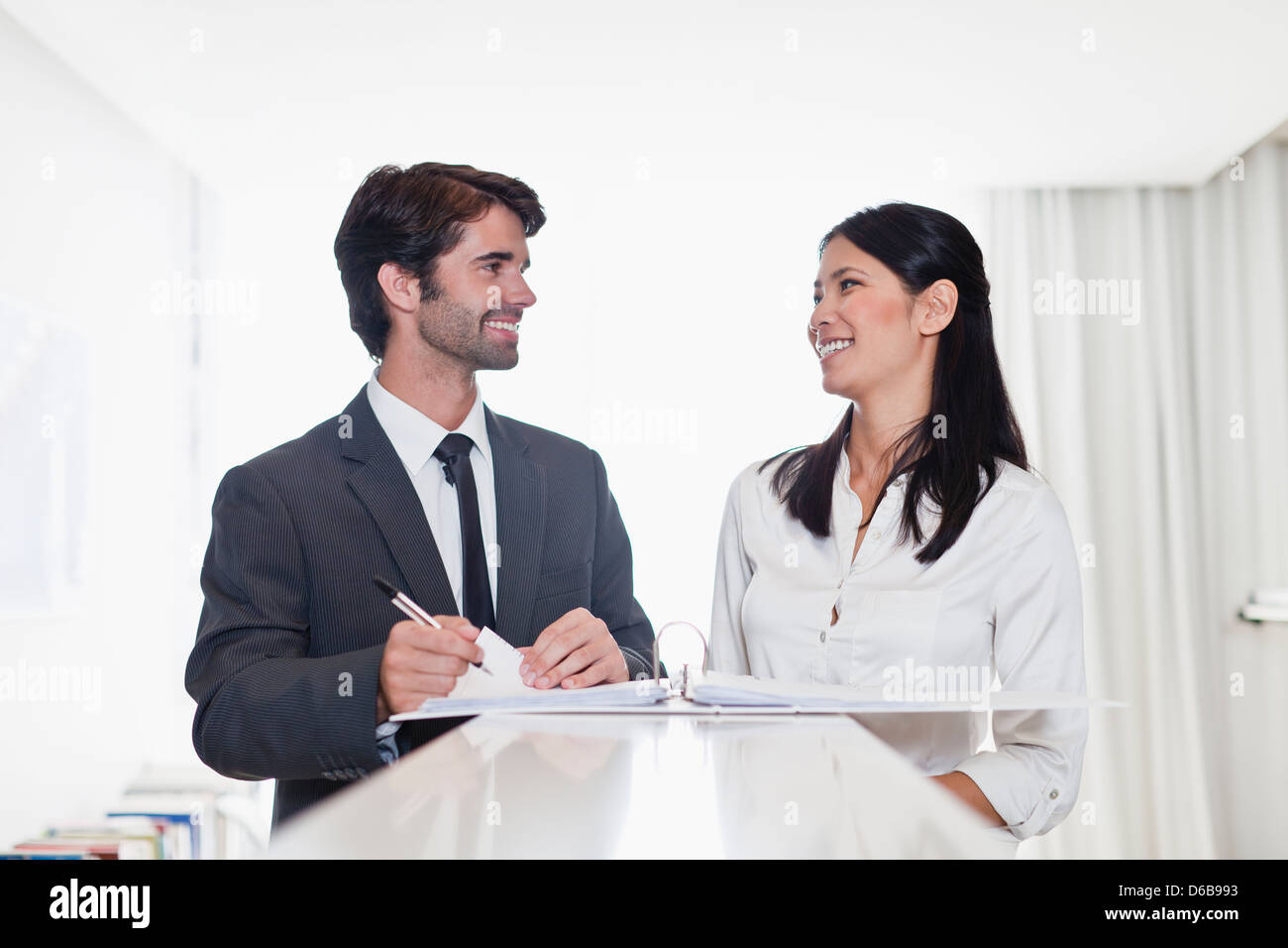 Business people smiling together - Stock Image