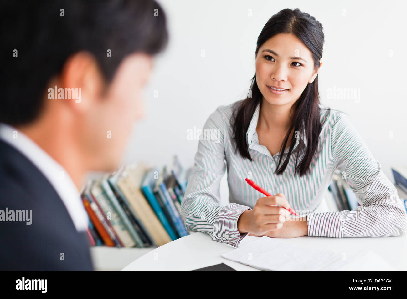 Business people talking at desk - Stock Image