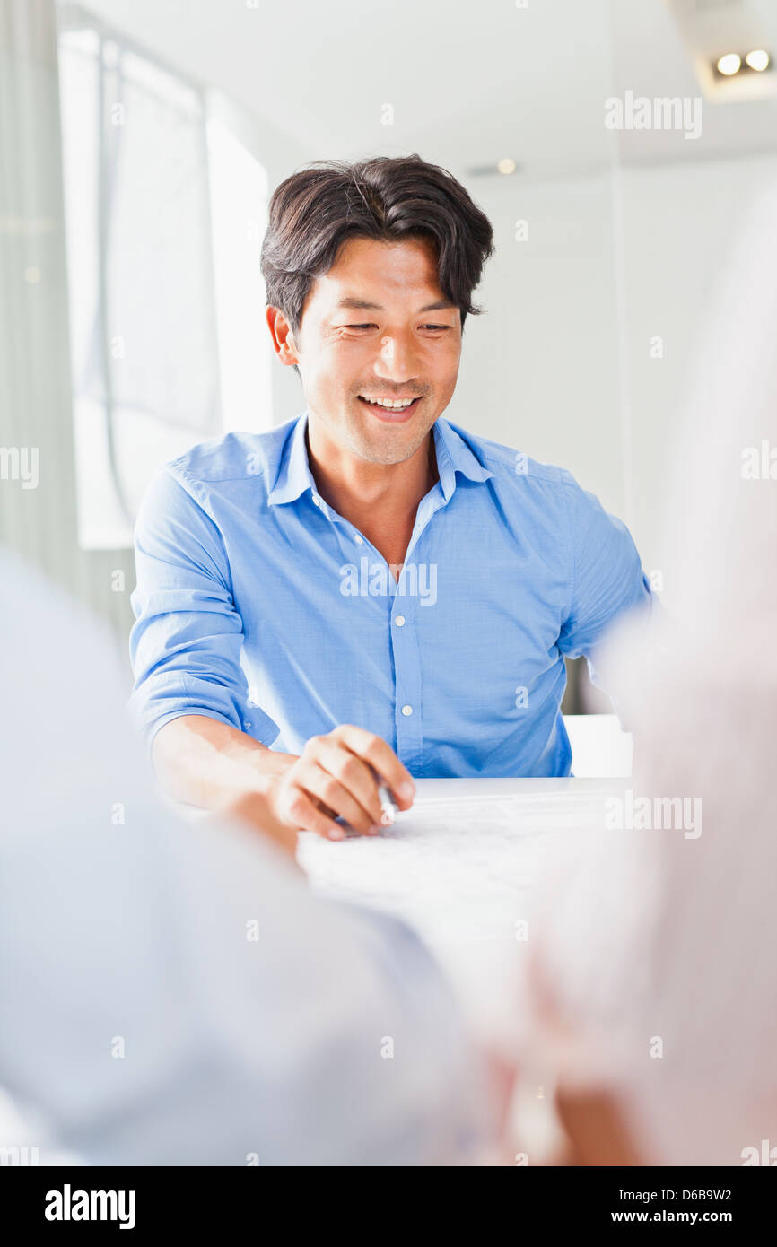 Businessman sitting in meeting - Stock Image