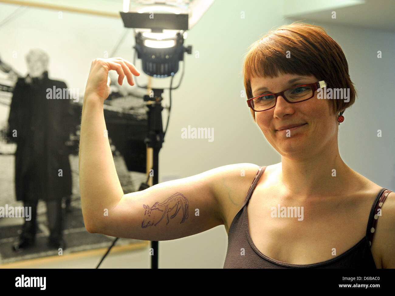 KatrinToelle, employee of the Kusthalle Emden, shows the tattoo design on her right arm in Emden,Germany, 24 August Stock Photo