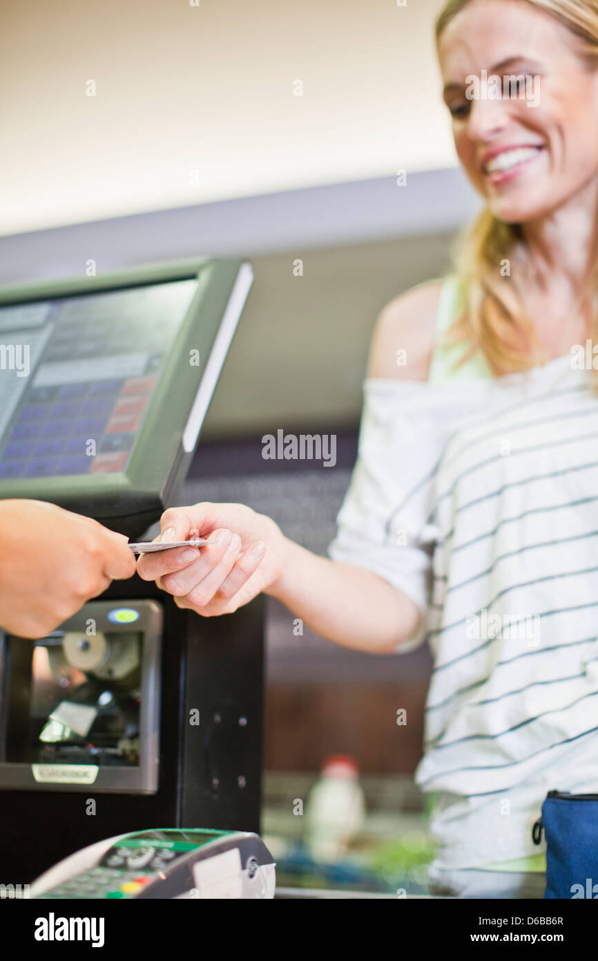 Woman paying with credit card in store Stock Photo