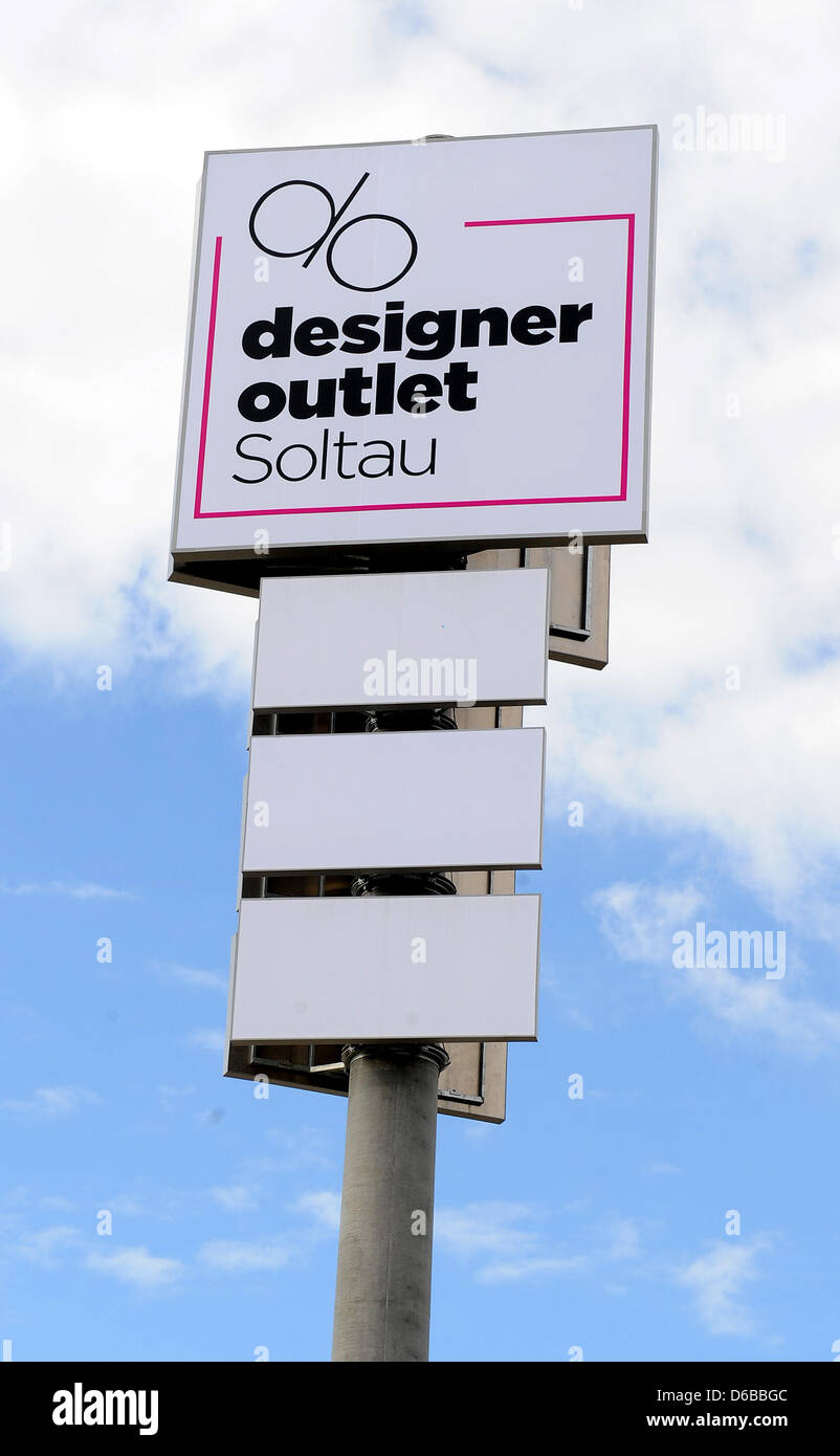 A large sign is pictured at the Designer Outlet Center in Soltau,Germany, 09August 2012. The 80 million euro project Stock Photo