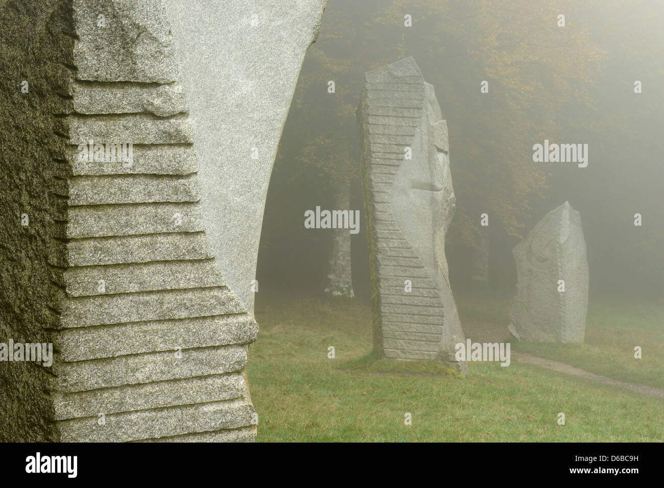 Standing stones at Heaven's Gate in the Longleat Estate, Wiltshire, UK. The stones were carved by artist Paul - Stock Image
