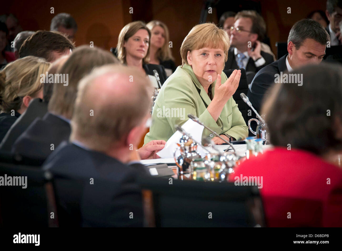 German Chancellor Angela Merkel (C) discusses the results of the work groups with experts discussing the future - Stock Image