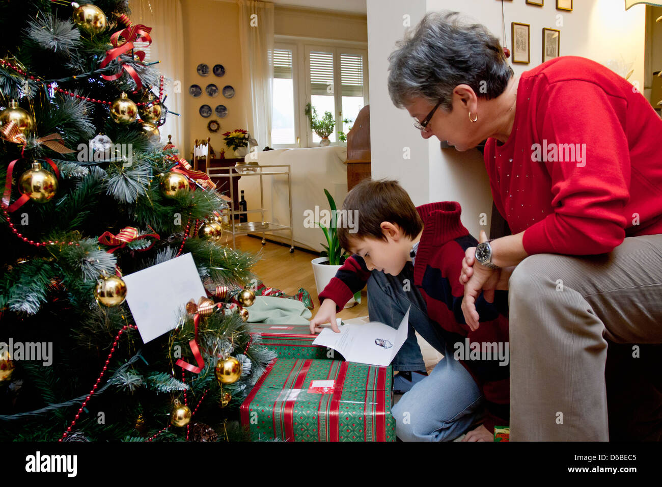 Woman and grandson with Christmas presents - Stock Image