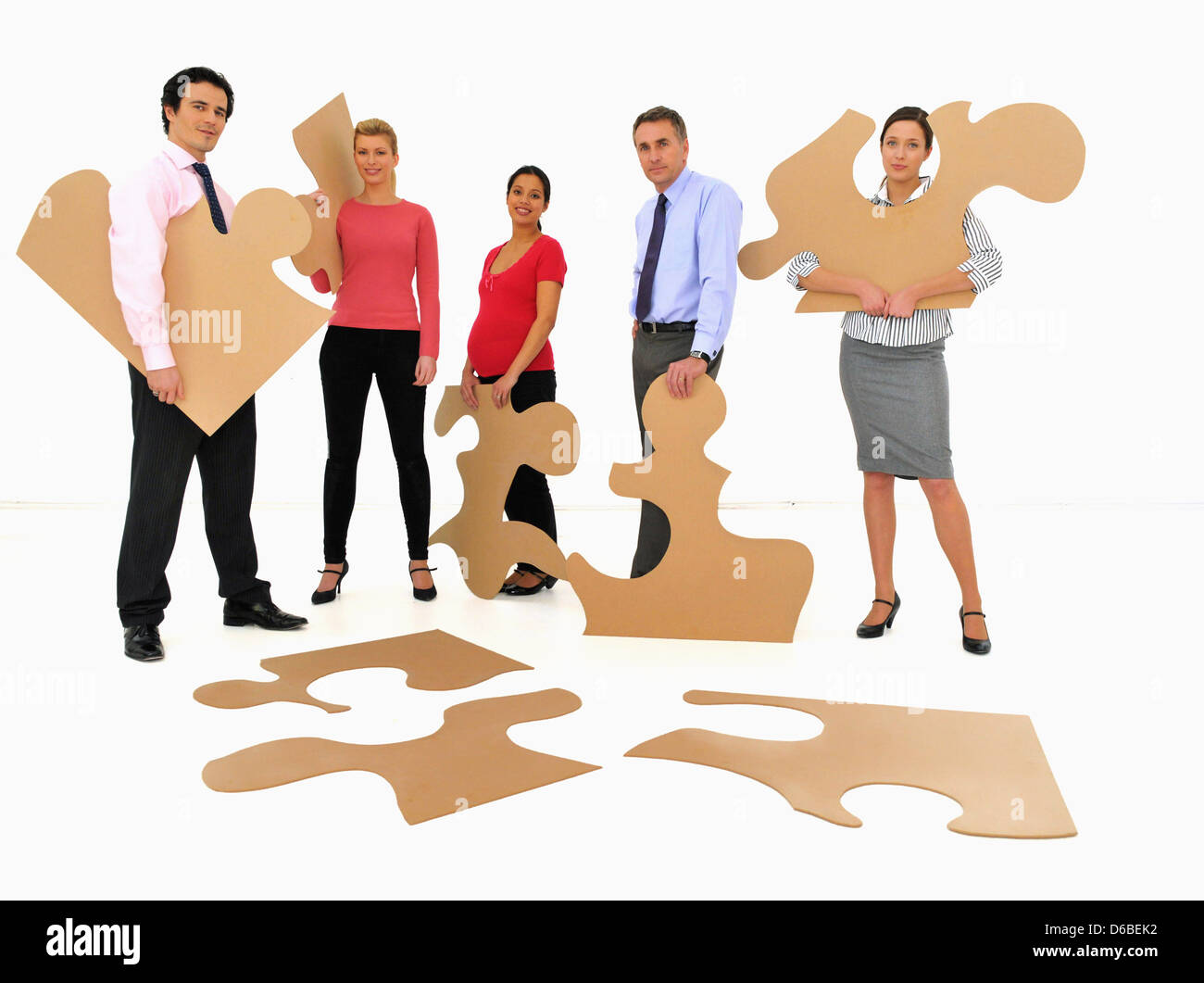 Business People Doing Jigsaw Puzzle Stock Photo 55572022