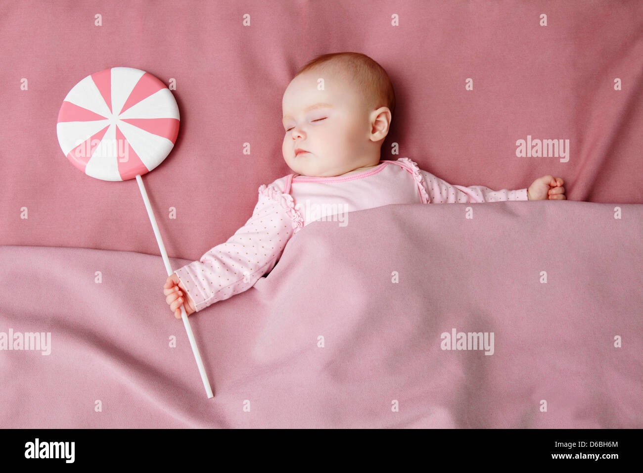 Baby girl sleeping in bed Stock Photo