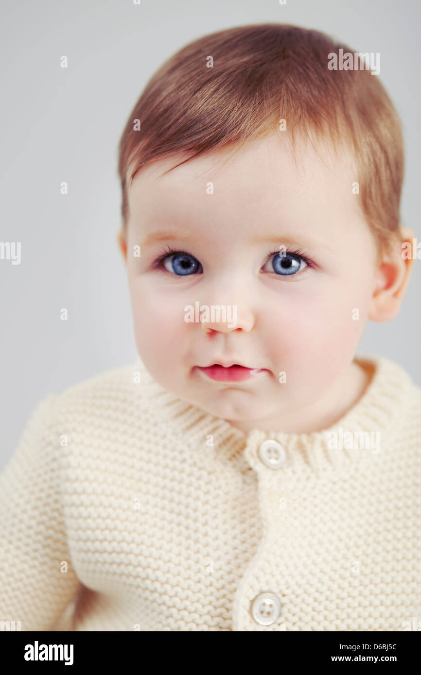 Close up of baby girls face - Stock Image