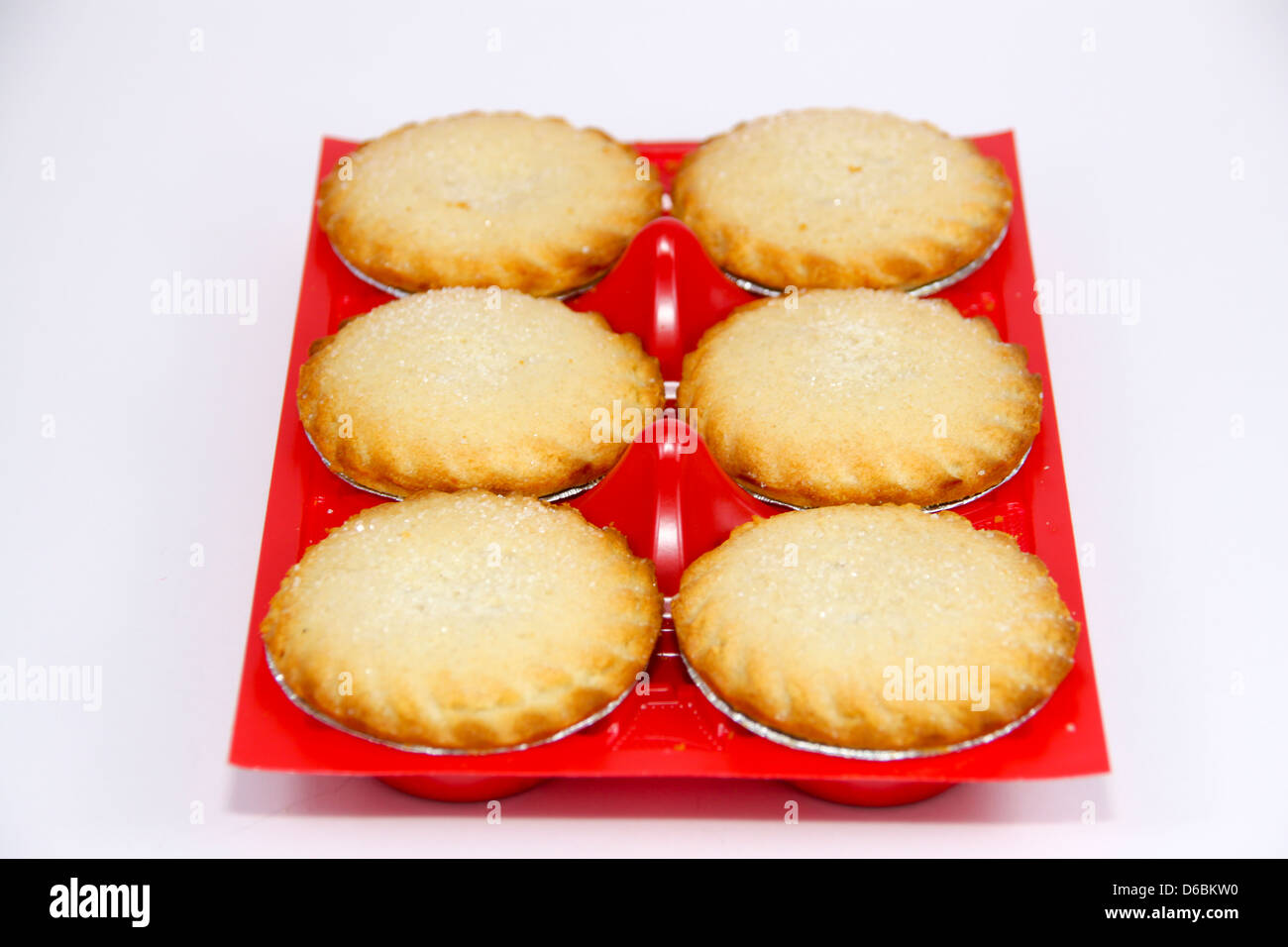 Shop bought individual apple pies in plastic tray - Stock Image