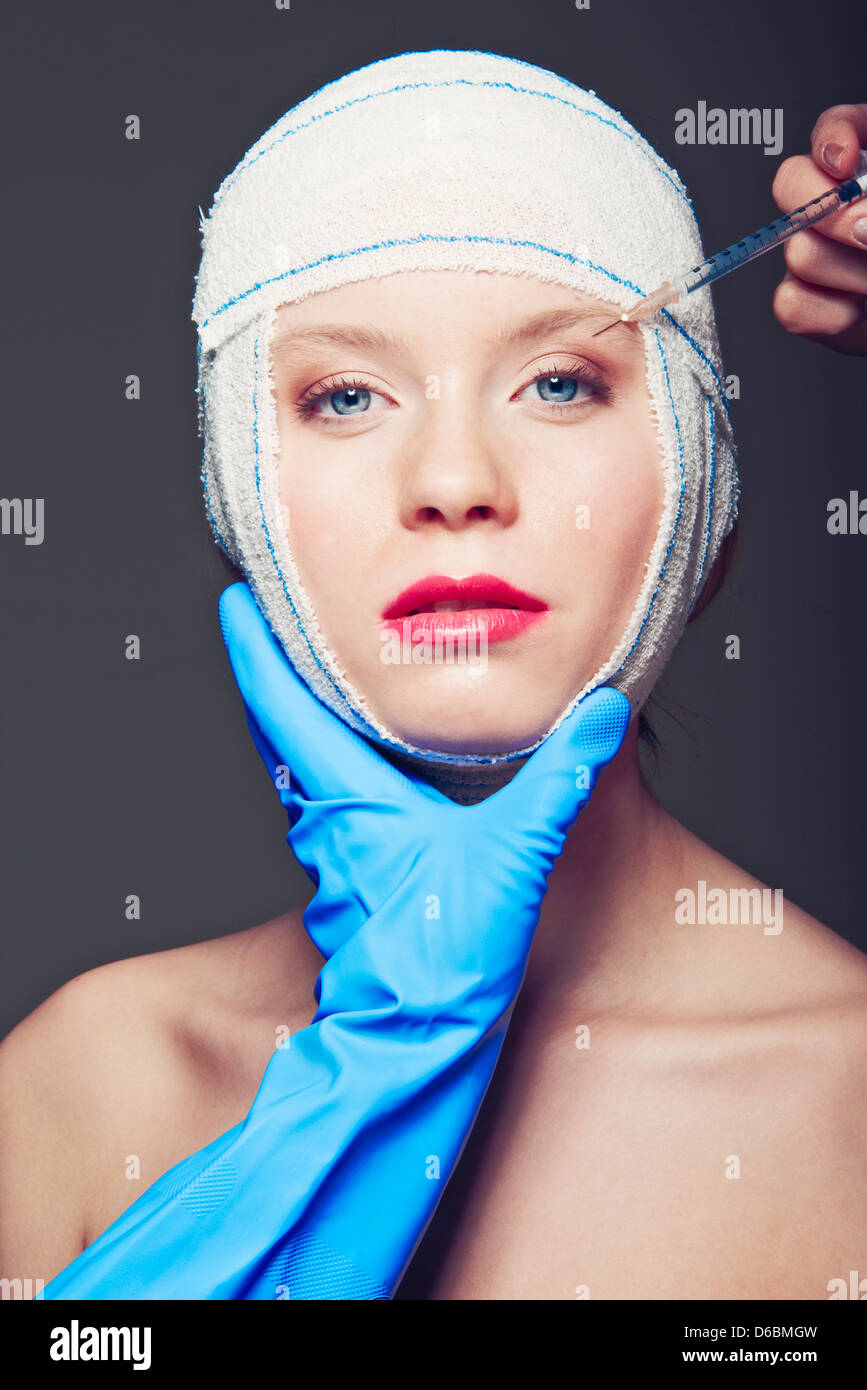 Woman in bandages having injection - Stock Image