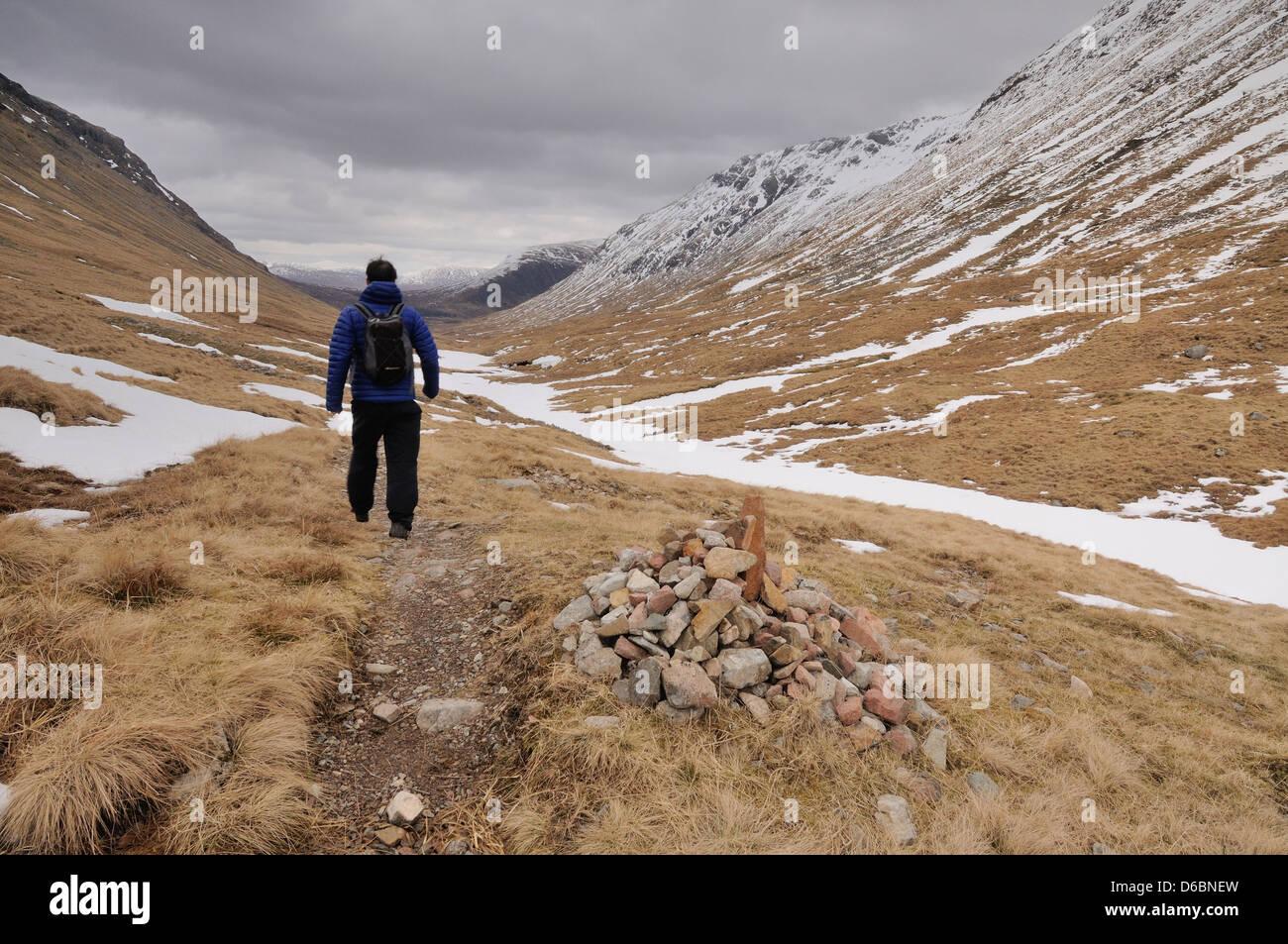 Walker on the Lairig Gartain pass in Glencoe, Scottish Highlands, Scotland - Stock Image