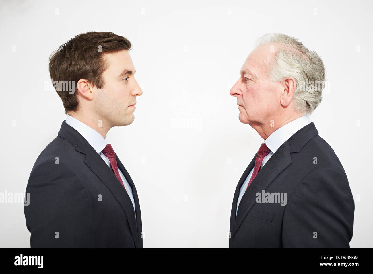 Businessmen facing each other - Stock Image