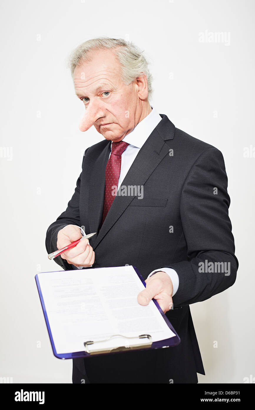 Businessman with long nose and contract - Stock Image