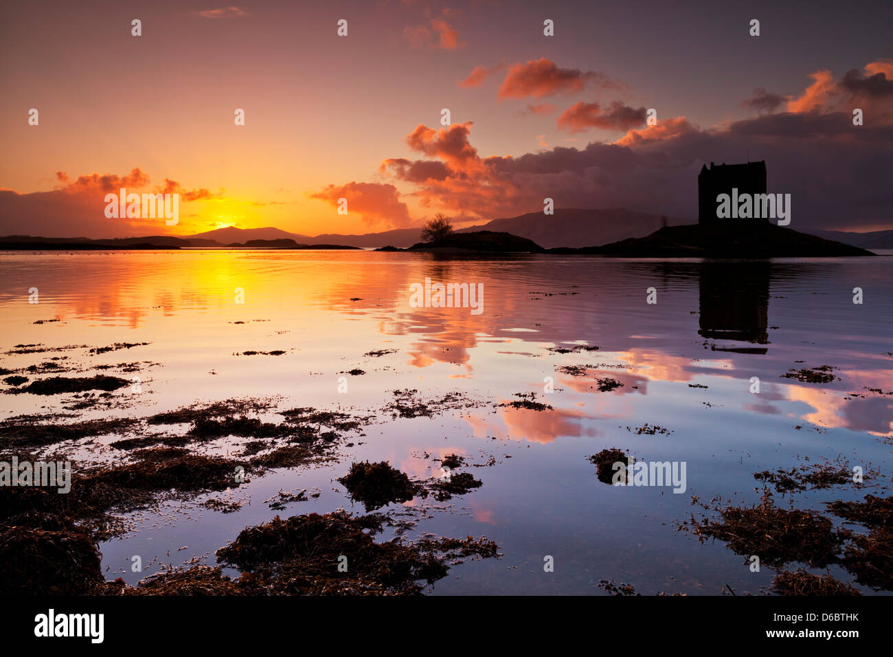 Silhouette at sunset of Castle Stalker Loch Laich Loch Linnhe Port Appin Argyll Scotland scottish highlands, UK, - Stock Image