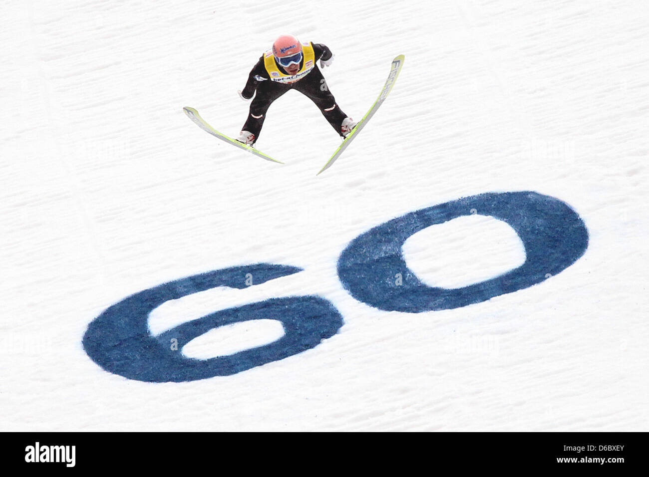 Austrian ski jumper Andreas Kofler jumps during the final round of the third jump at the 60th Four Hills Tournament - Stock Image
