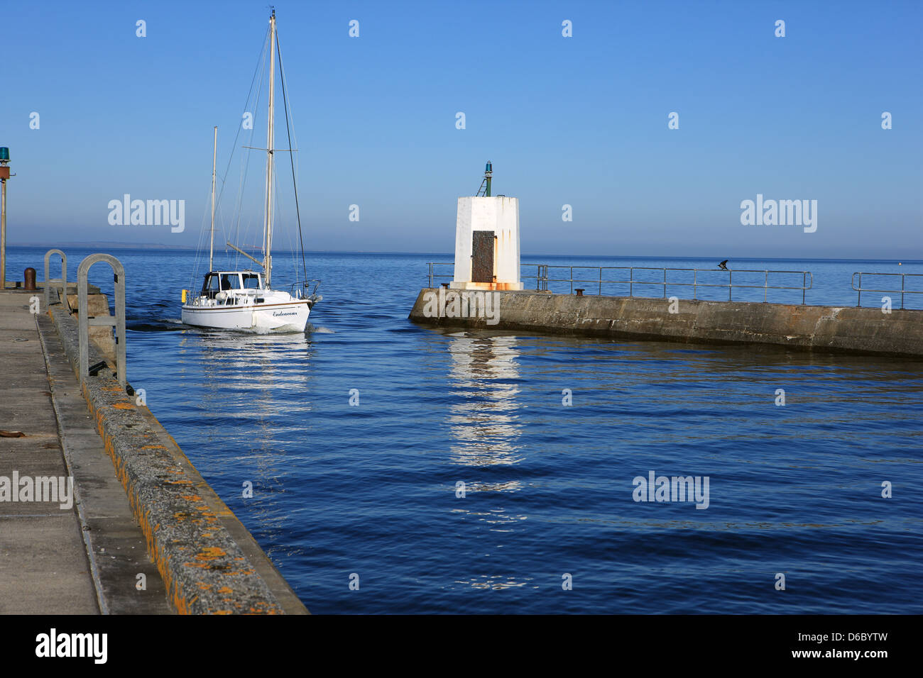Yacht entering Nairn Harbour in the Highlands of Scotland - Stock Image