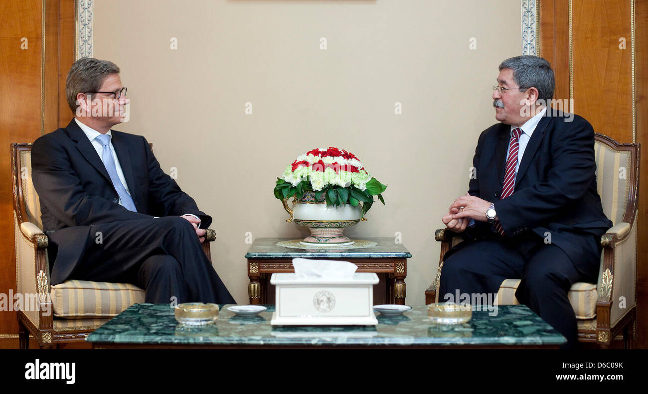 Bundesaußenminister Guido Westerwelle (FDP, l) trifft am Samstag (07.01.2012) in Algier den Premierminister der Stock Photo