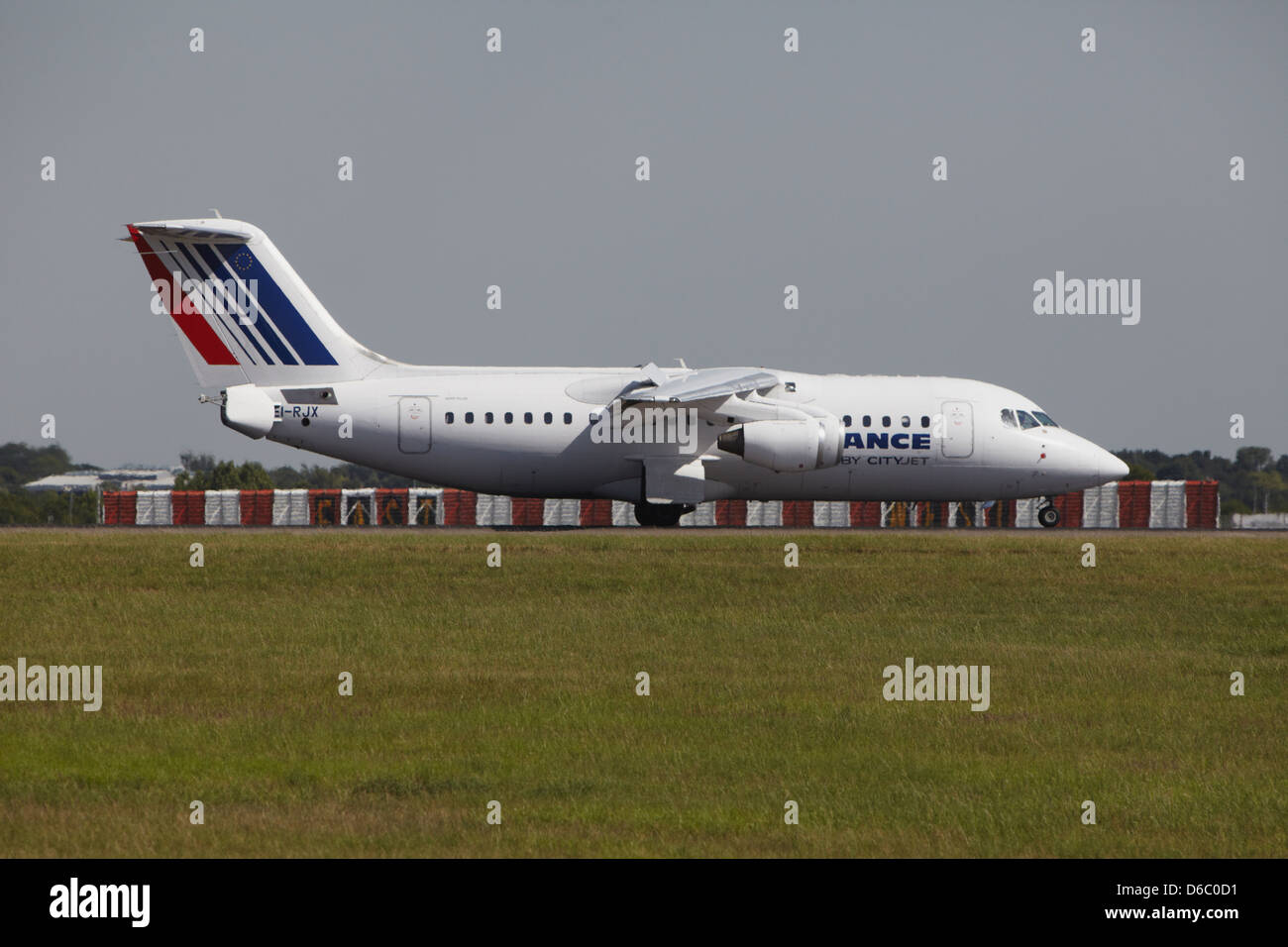 Cityjet (Air France) BAe Avro RJ85 slowing down after landing - Stock Image
