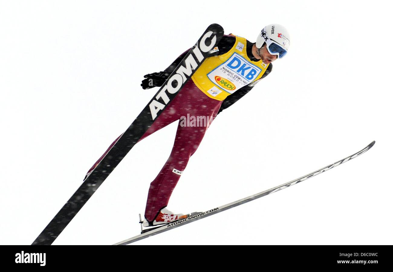 French athlete Jason Chappuis Lamy takes a jump to the coach's arms at the Schattenwald ski jump during the - Stock Image