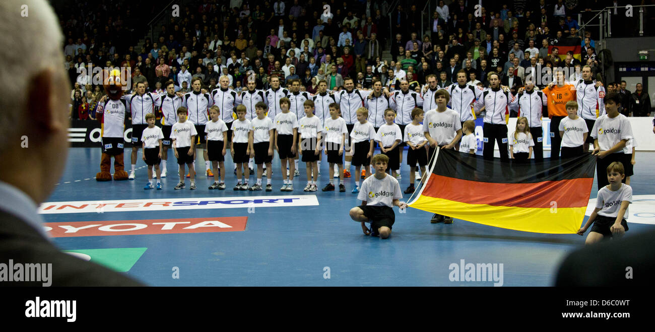 The team of Germany is seen before the handball international match between Germany and Hungary at the Getec-Arena - Stock Image