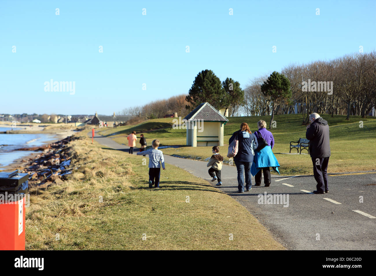 Family walking along the promenade at Nairn in the Highlands of Scotland - Stock Image