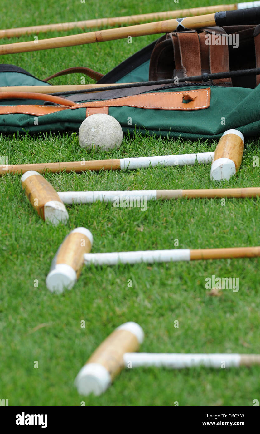 Mallets and a polo ball are seen during the German Polo Championship at the Berlin May field in Berlin, Germany, - Stock Image