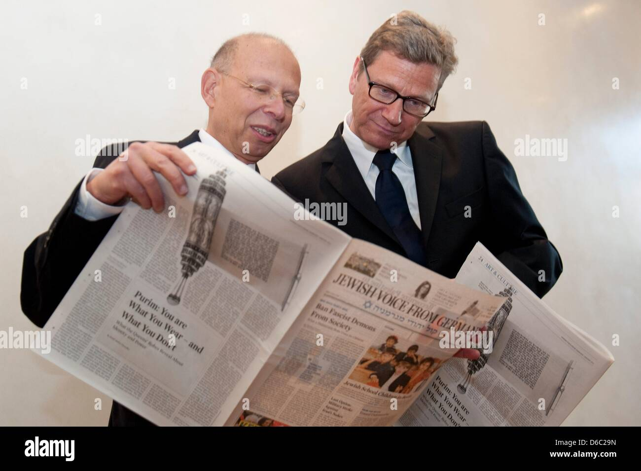 Publicist Rafael Seligmann (L) and Germany Foreign Minister Guido Westerwelle leaf through the first edition - Stock Image