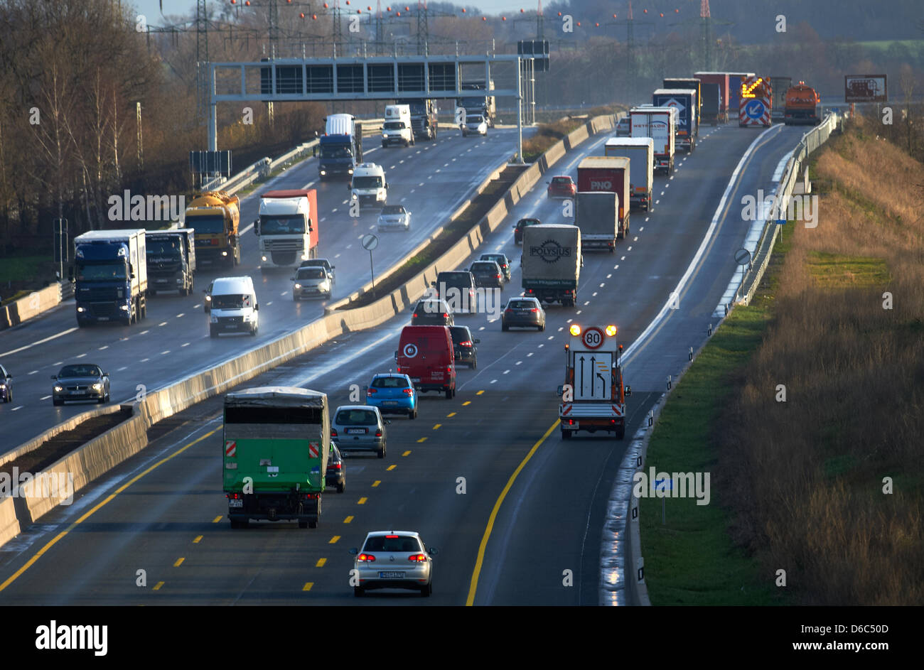 Trucks and cars travel along the A2 near Boenen, Germany, 13 January 2012. The six-lane expansion of the A2 Oberhausen Stock Photo