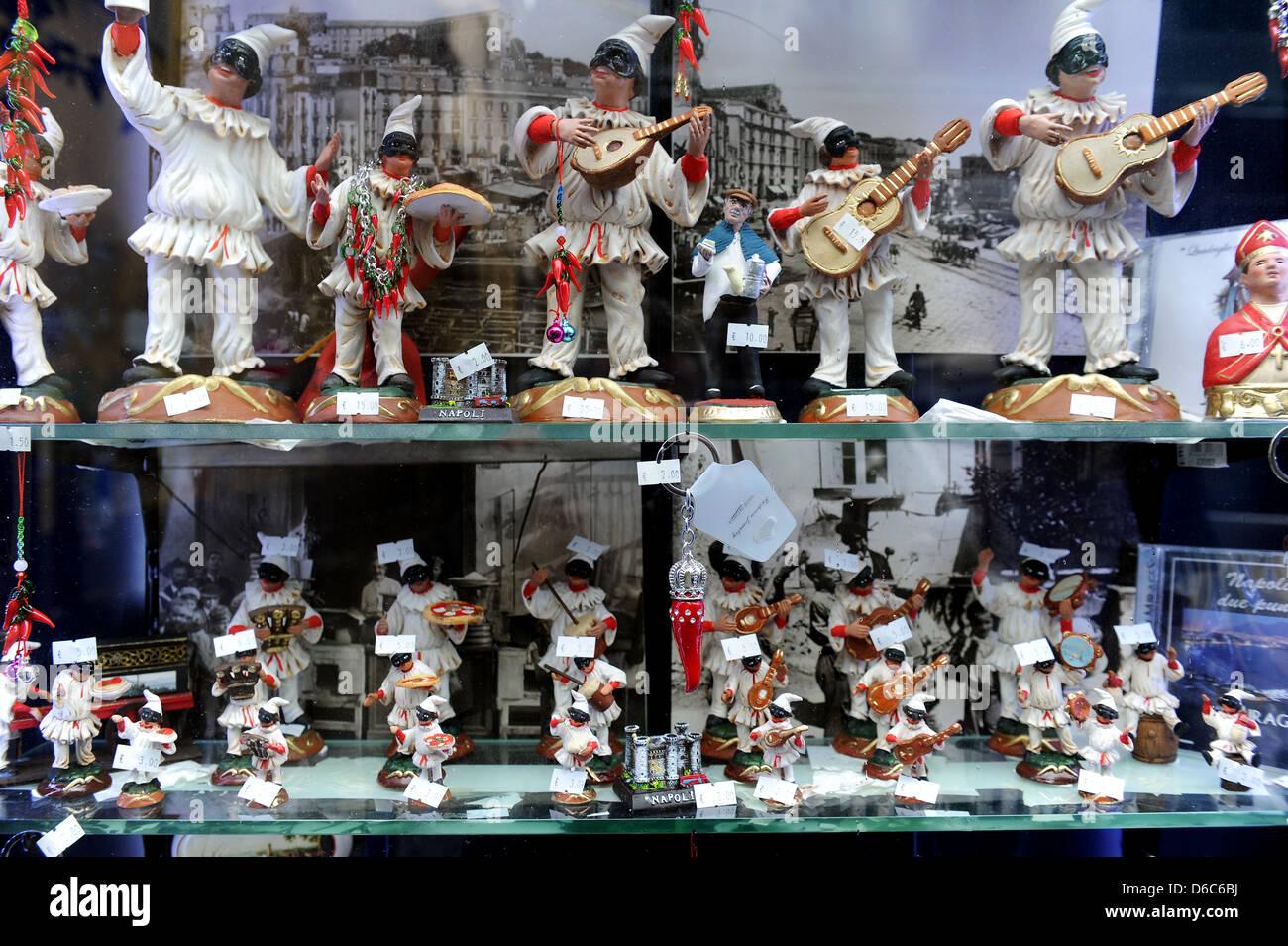 Pulcinella dolls in a shop window display, Naples, Itlay. - Stock Image
