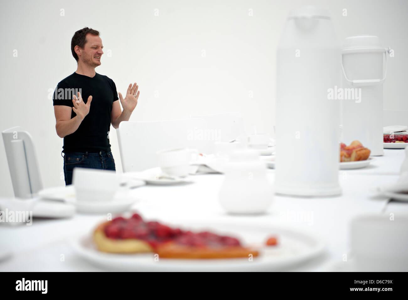 The Belgian artist Hans Op de Beeck presents his installation 'Table (1)' (2006, various materials) at Kunstverein - Stock Image