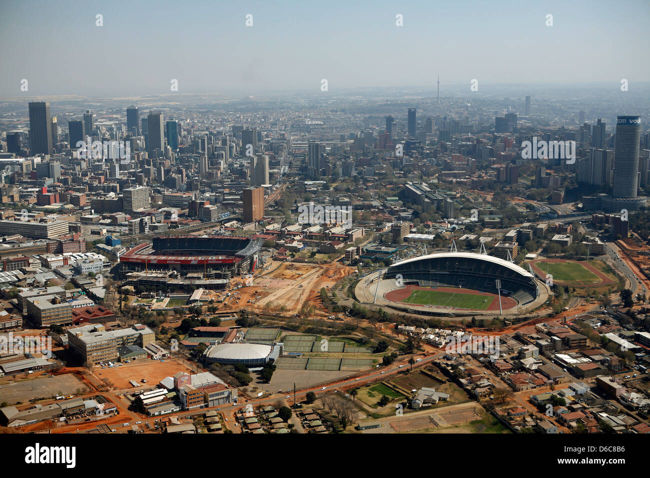 Aerial view of Johannesburg cityscape showing Ellis Park Rugby and Johannesburg Stadiums - Stock Image