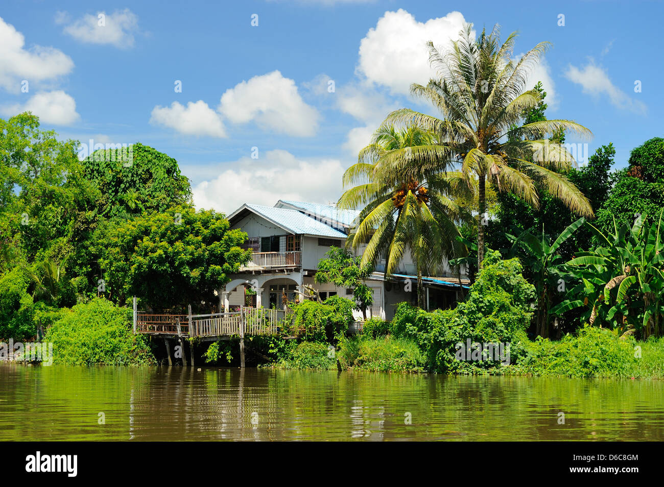 Waterside residence on the Sungai Sarawak River in Kuching, Sarawak, Borneo - Stock Image