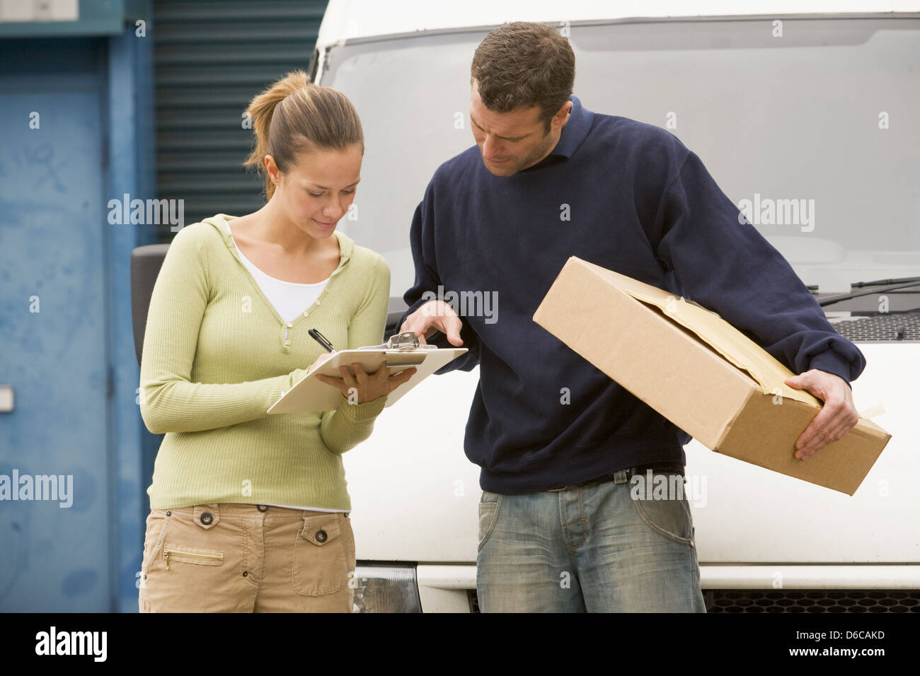 parcel service,addressee,confirmation receipt,delivery people - Stock Image