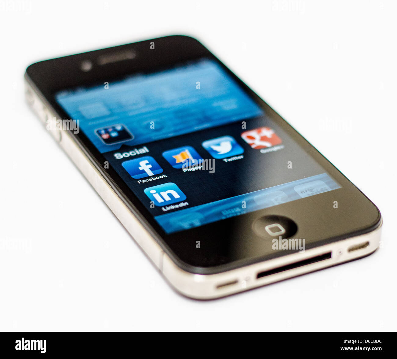 Apple iPhone on white background showing a selection of social media applications - Facebook, Twitter, Google+, - Stock Image