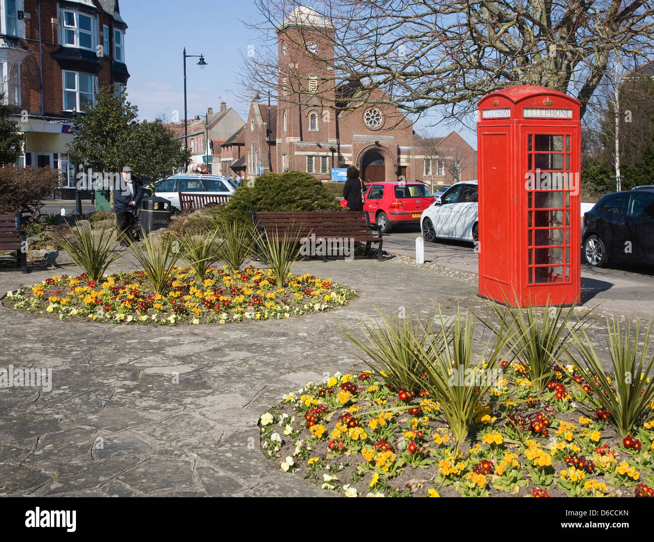 Gardens red telephone box Frinton on Sea, Essex, England - Stock Image