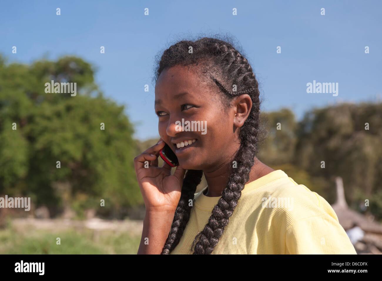 Young Ethiopian woman using her cell phone, Awasa, Ethioipia - Stock Image