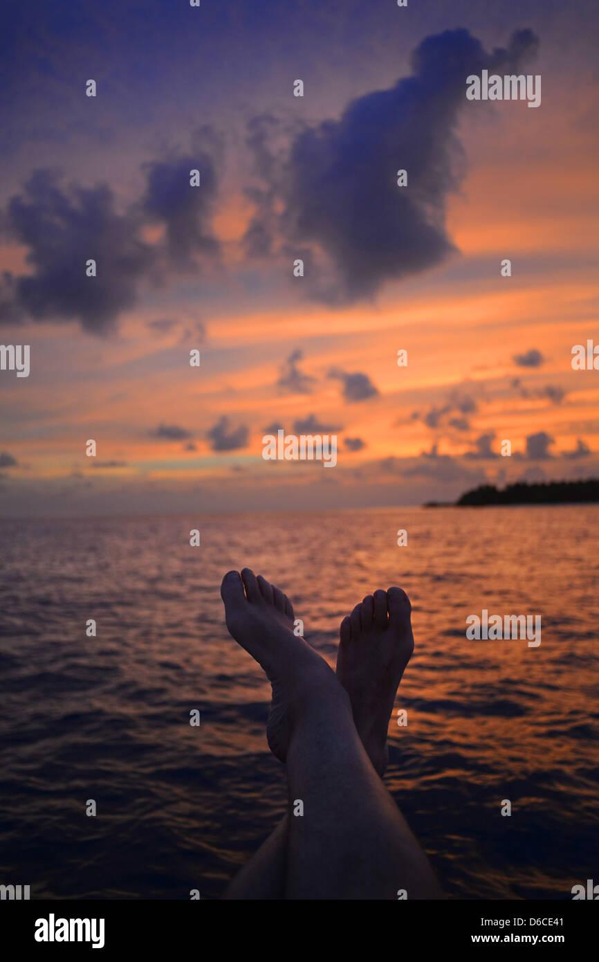 Admiring the sunset over Kuramathi Island in The Maldives - Stock Image