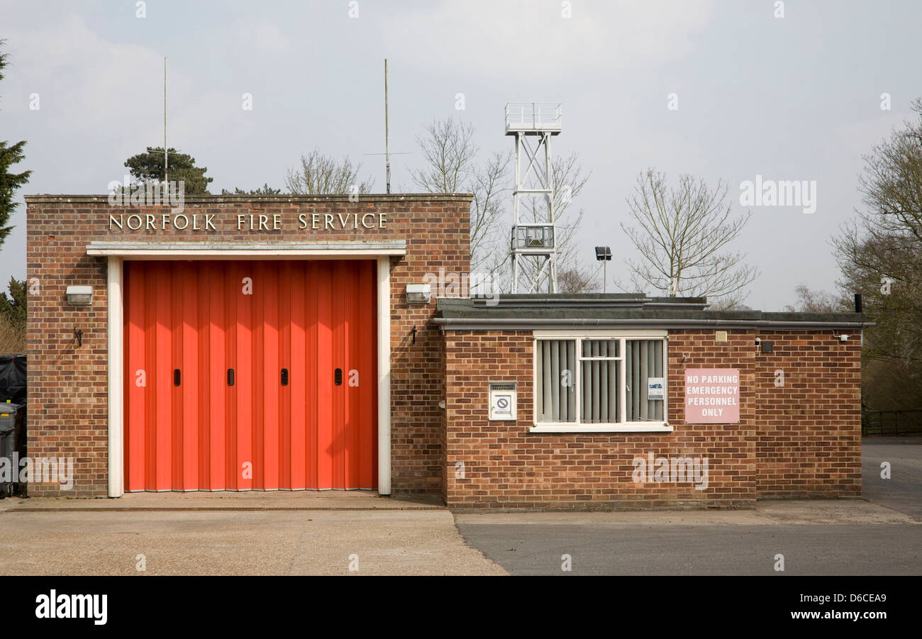 Red doors of small fire station at Loddon, Norfolk, England - Stock Image